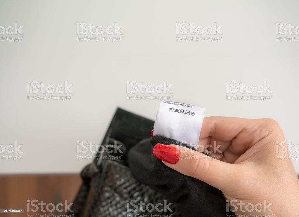 clothing label with wash directions stock photo