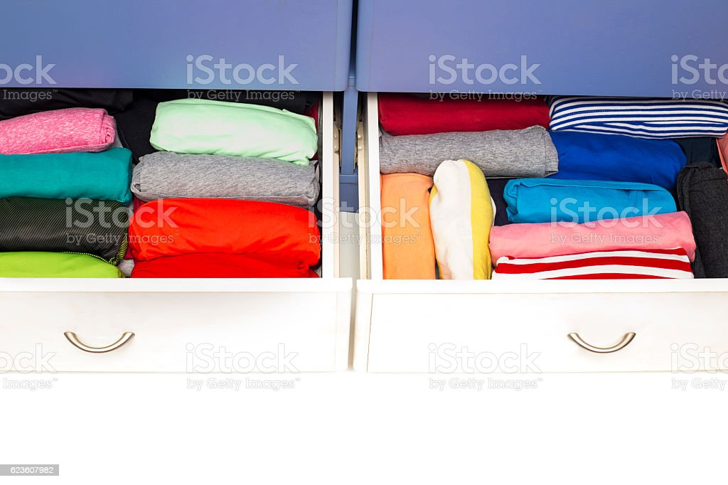 Clothing lying in the drawer in the wardrobe. stock photo