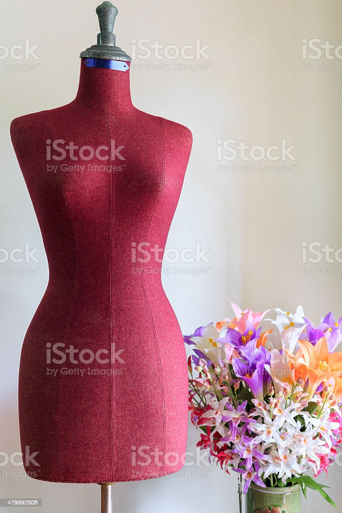 Clothing mannequin with flowers vase stock photo