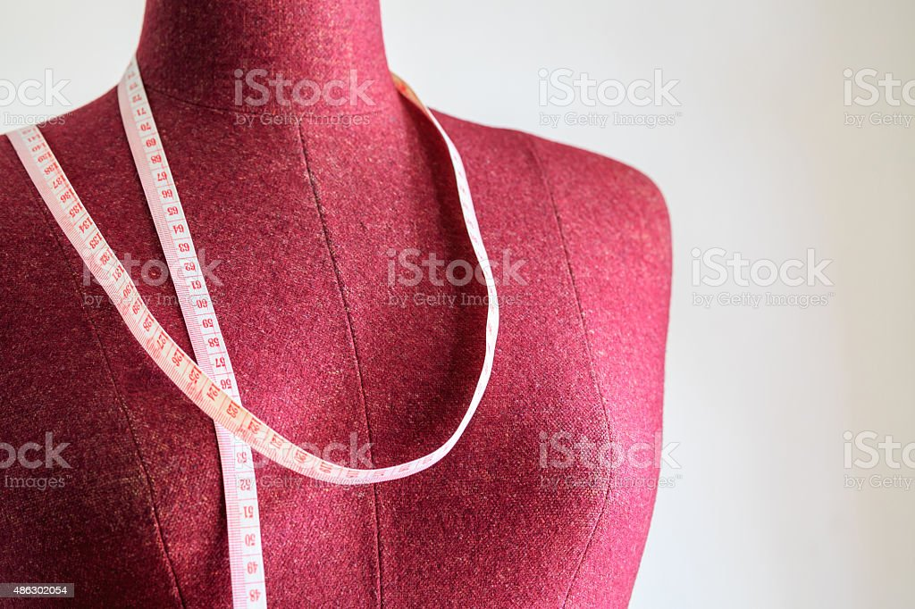 Clothing mannequin with measuring tape stock photo