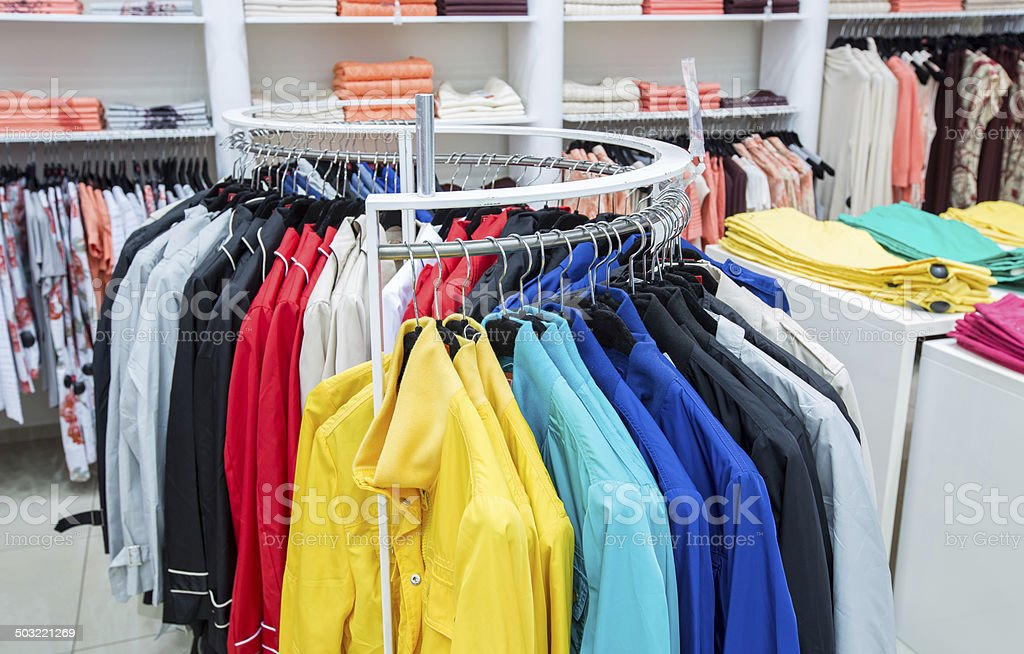Clothing on hangers in shop royalty-free stock photo