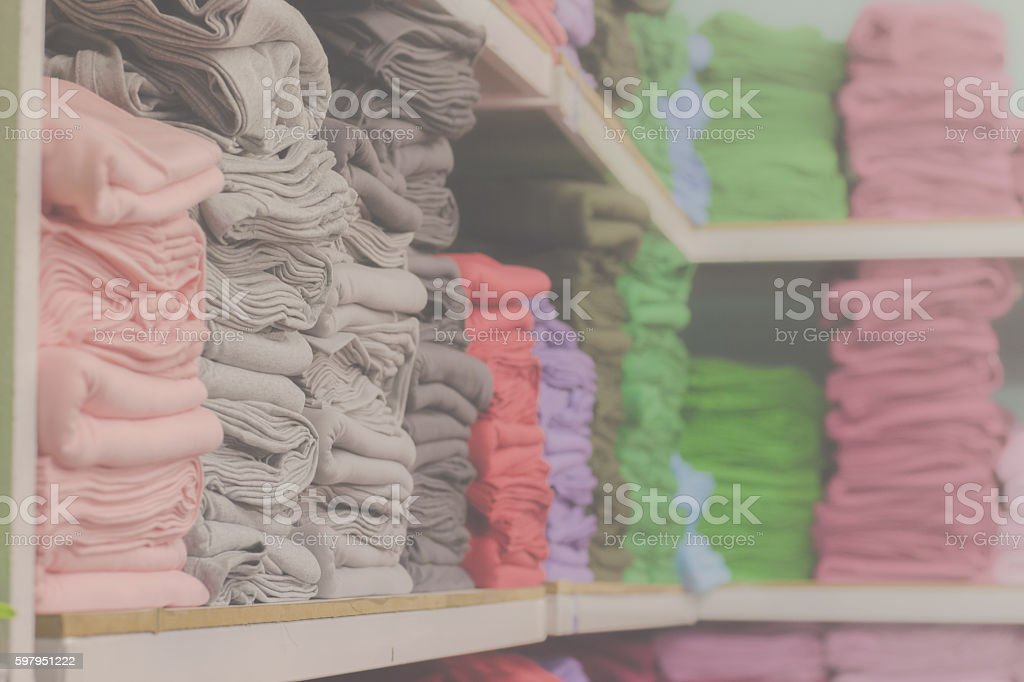 Clothing sold in the market, the clothes on the shelf stock photo