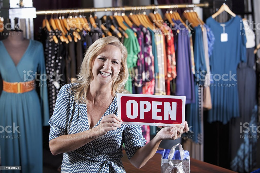 Clothing store open for business stock photo