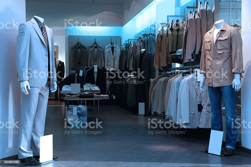 Clothing store with various men clothing and suits stock photo