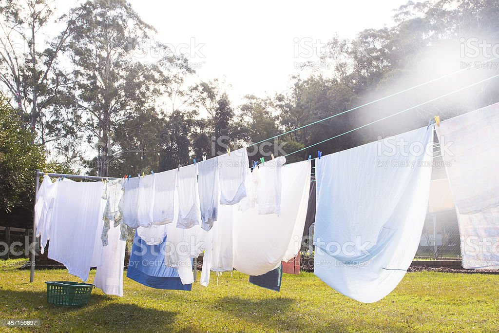 Cloths are hanging on clothesline stock photo