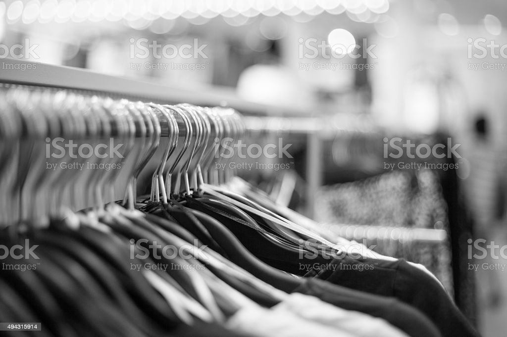 Cloths on a Rack in Fashion Shop stock photo