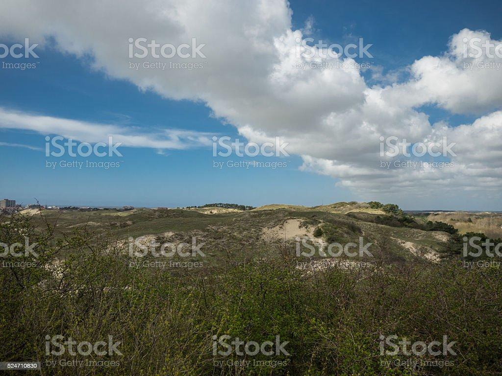 Cloud bank over the dunes stock photo
