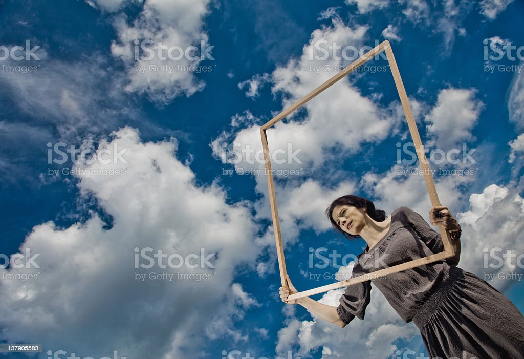 Cloud catching woman royalty-free stock photo