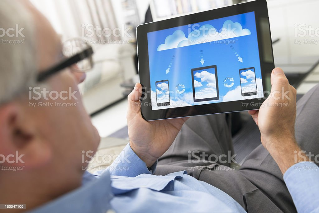 Cloud computing application on digital tablet royalty-free stock photo