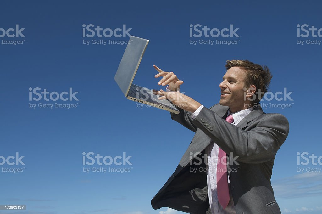 Cloud Computing Businessman Typing on Laptop Floating in Sky royalty-free stock photo