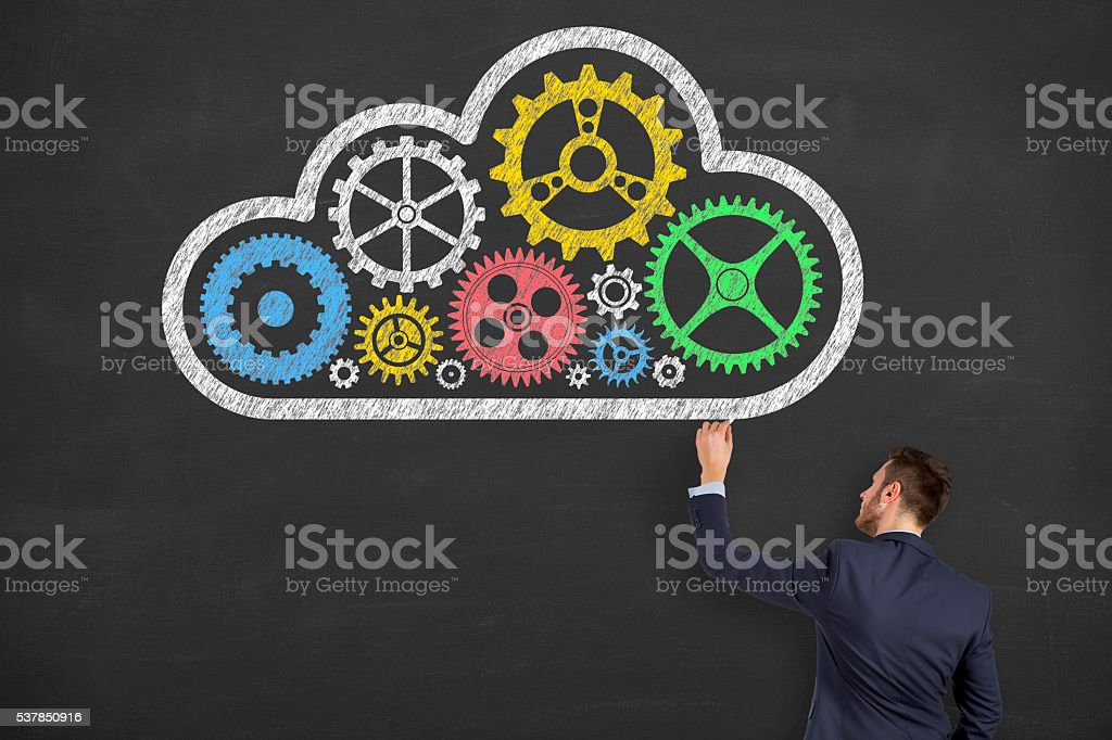 Cloud Computing Solution Gear on Blackboard Background stock photo