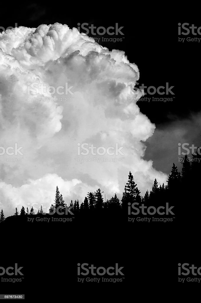 cloud formation in high mountains stock photo