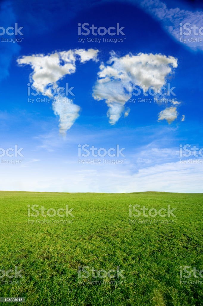 Cloud Formation in World Map Over Green Grass Field royalty-free stock photo