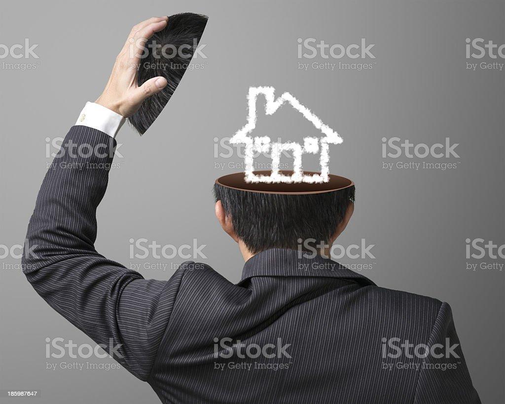 Cloud house inside businessman's head royalty-free stock photo