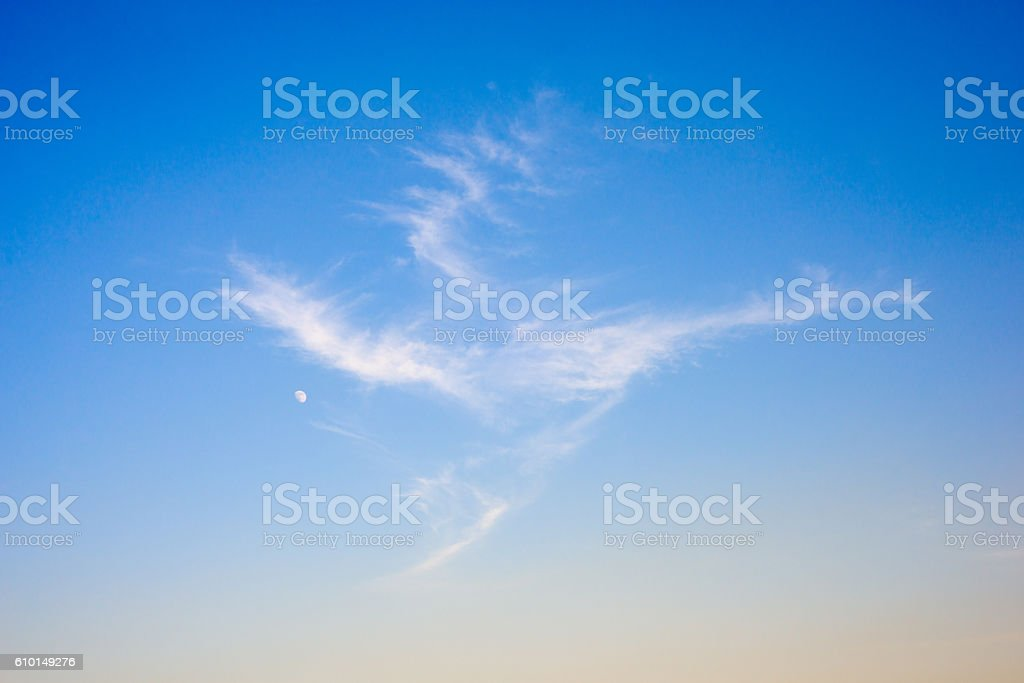 Cloud in shape of dragon and  serene blue sky stock photo