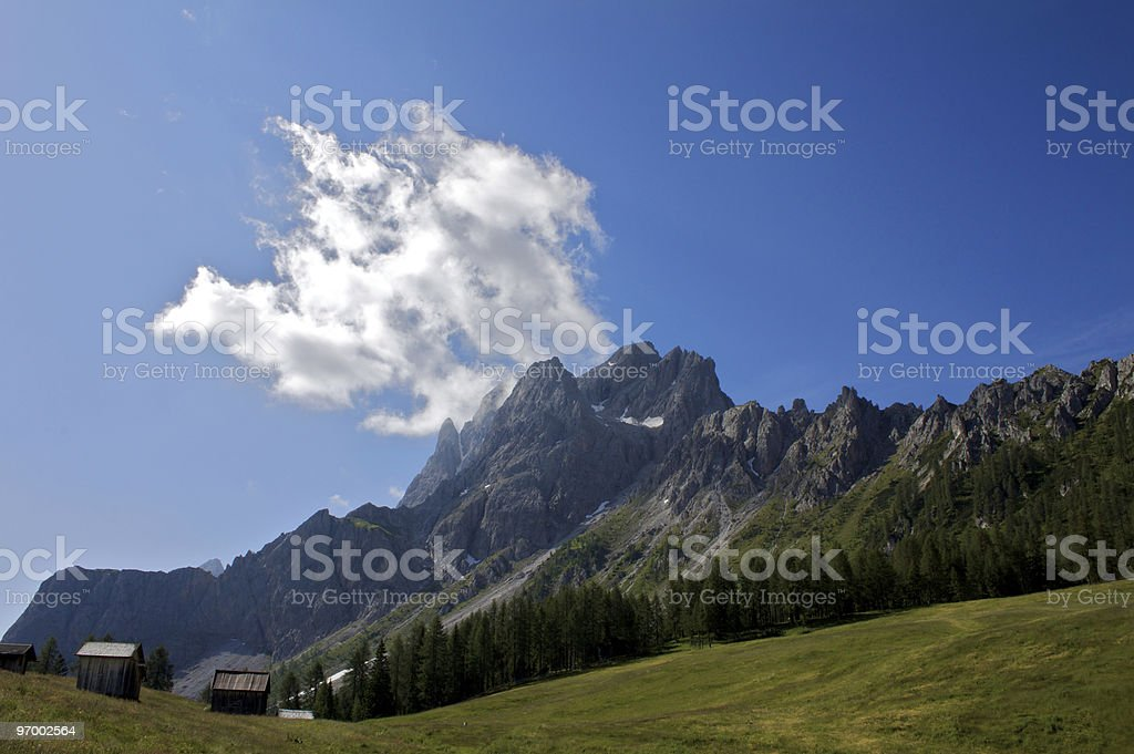 Cloud in the dolomites mountains stock photo