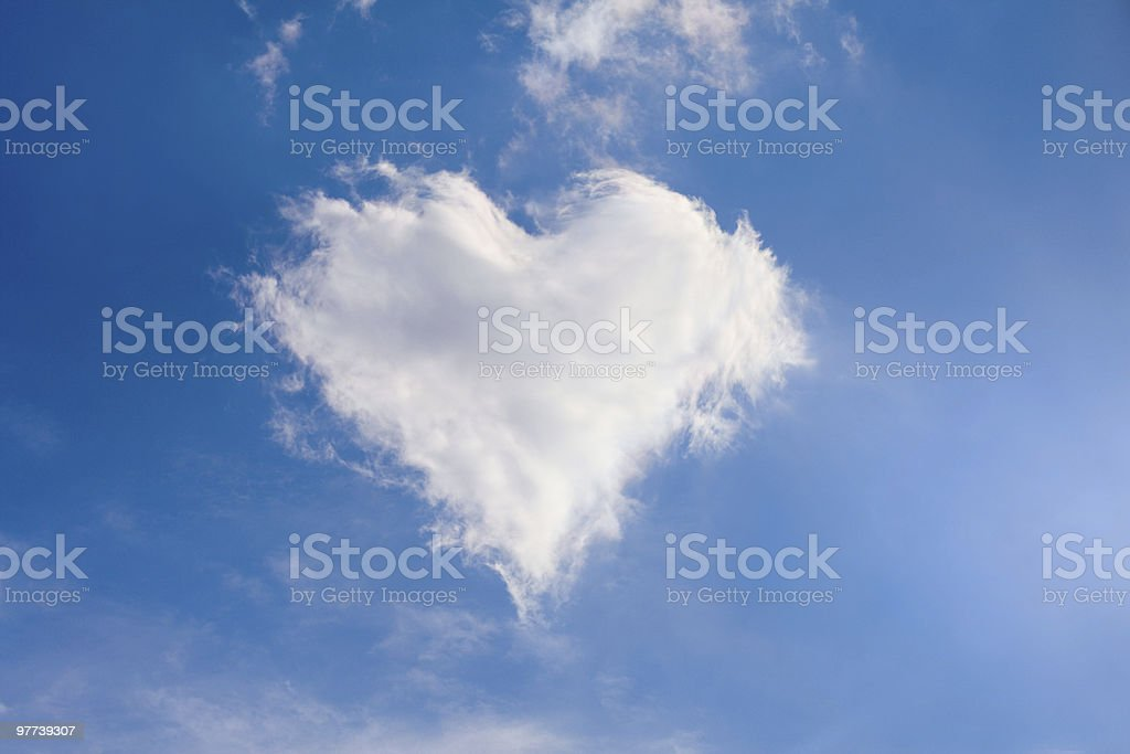 A cloud in the sky in the shape of a heart stock photo