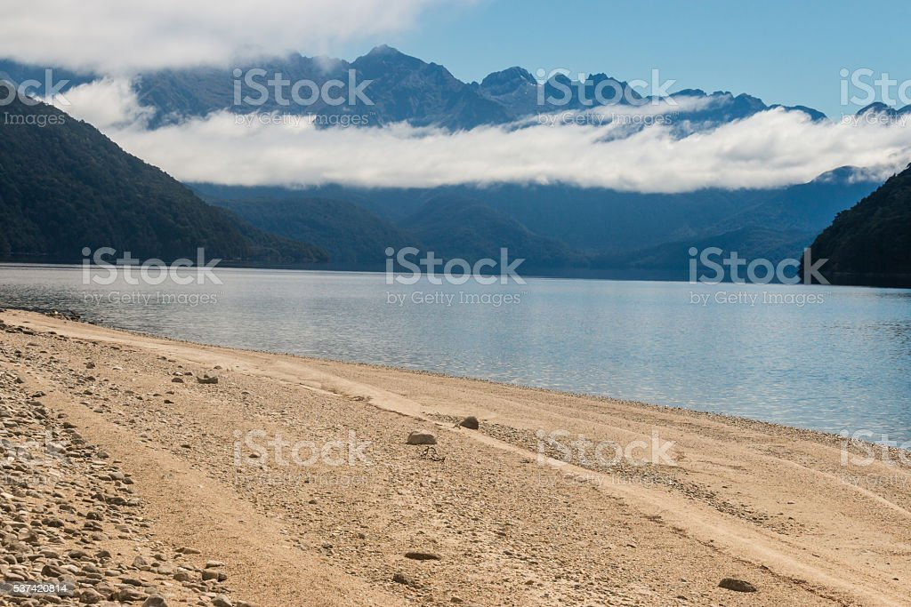 cloud inversion above lake Manapouri in New Zealand stock photo