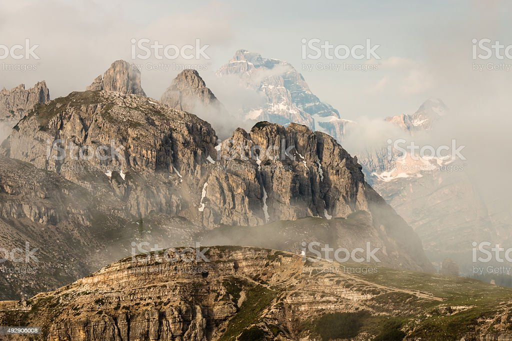 cloud inversion over Dolomites peaks stock photo