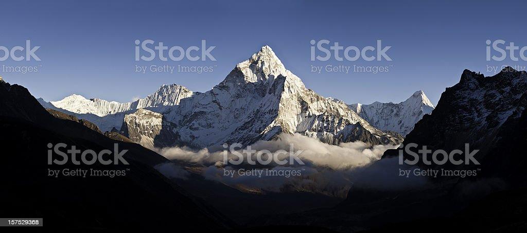 Cloud mountain peak white summit panorama Ama Dablam Himalayas Nepal stock photo