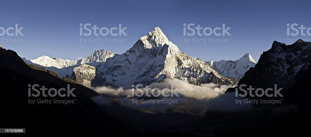 Cloud mountain peak white summit panorama Ama Dablam Himalayas Nepal stock photo