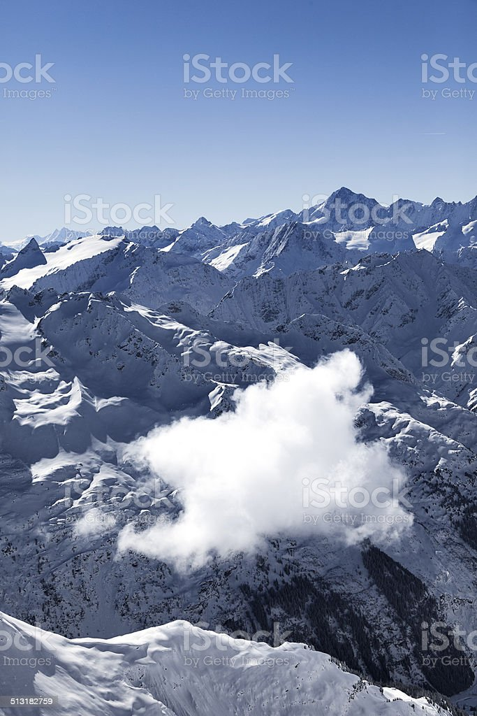 cloud number nine flying over the swiss alps stock photo
