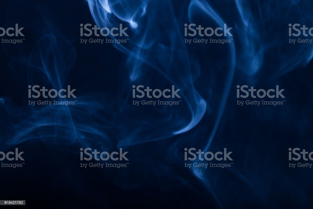 Cloud of smoke on black background. Selective focus. Toned stock photo