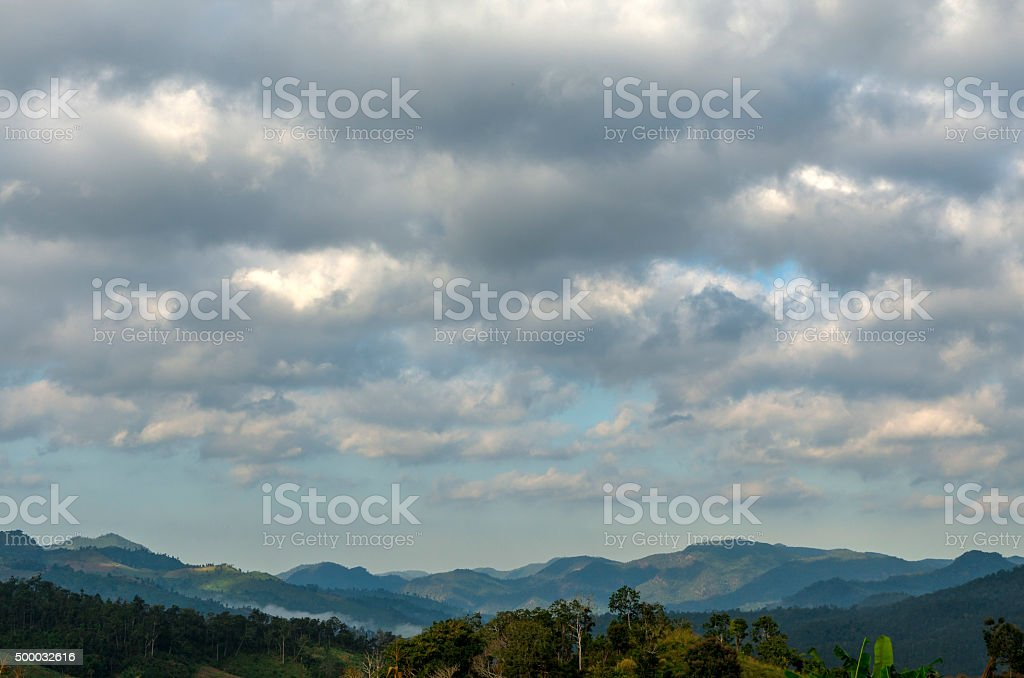 Cloud over mountains stock photo