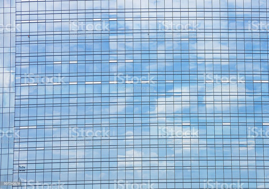 cloud reflect in glass wall stock photo