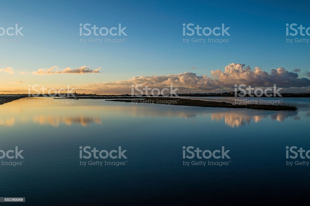 Cloud reflection in water stock photo