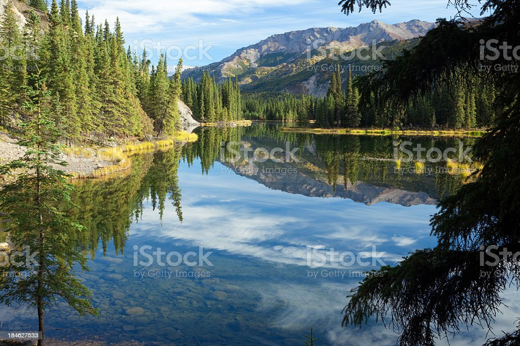 Cloud reflections in Horseshoe Lake in Alaska stock photo