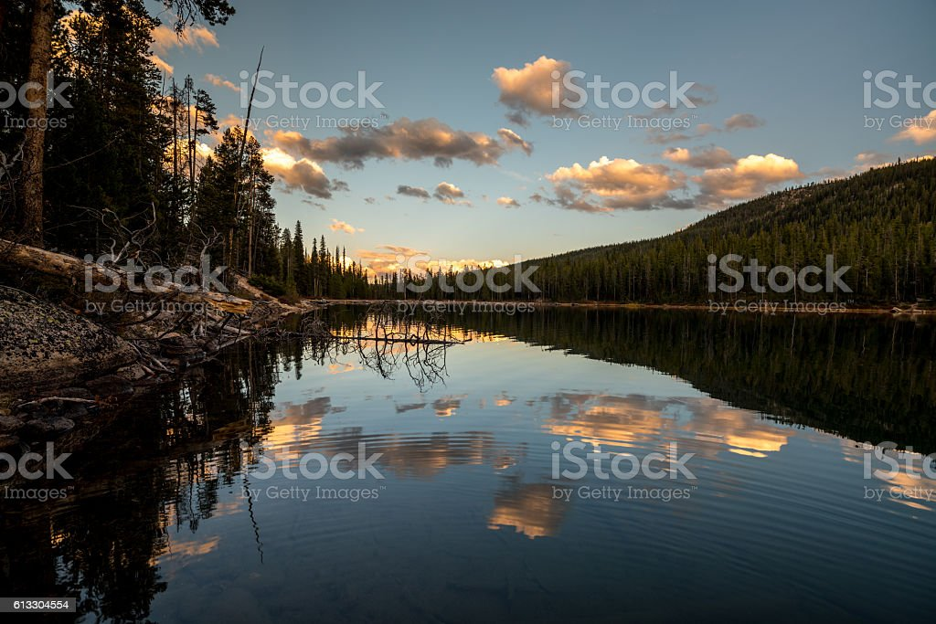 Cloud reflections of evening in an Idaho mountain lake stock photo