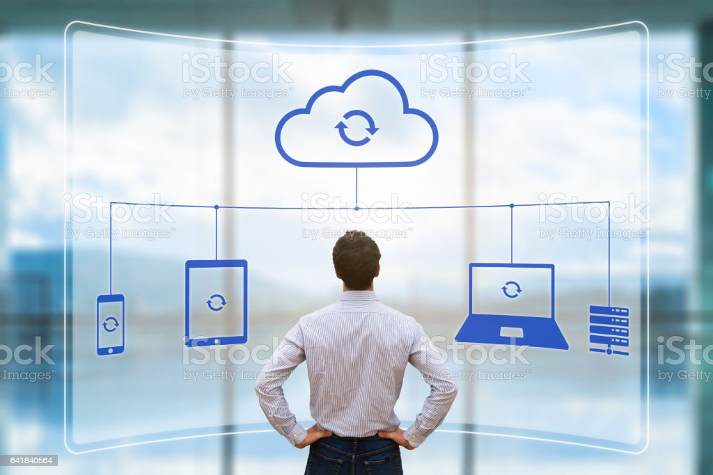 Cloud synchronizing between devices concept, virtual screen, syncing data, businessman stock photo