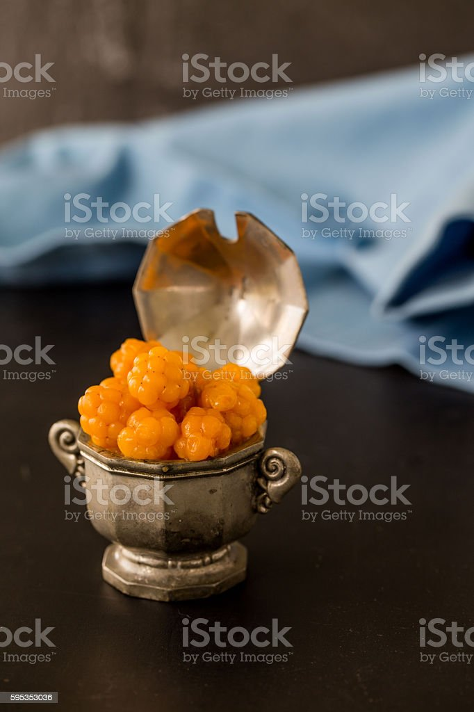 Cloudberries on wooden background stock photo