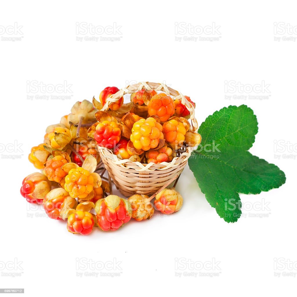 Cloudberry with leaves in the basket stock photo