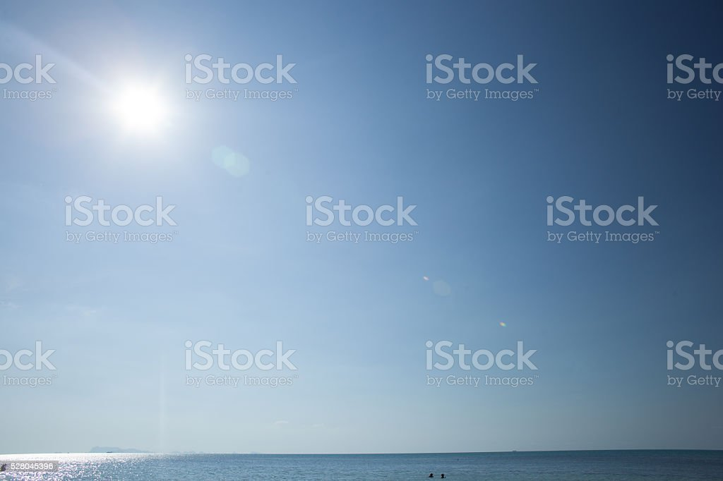 Cloudless blue sky, ove sea with sun stock photo