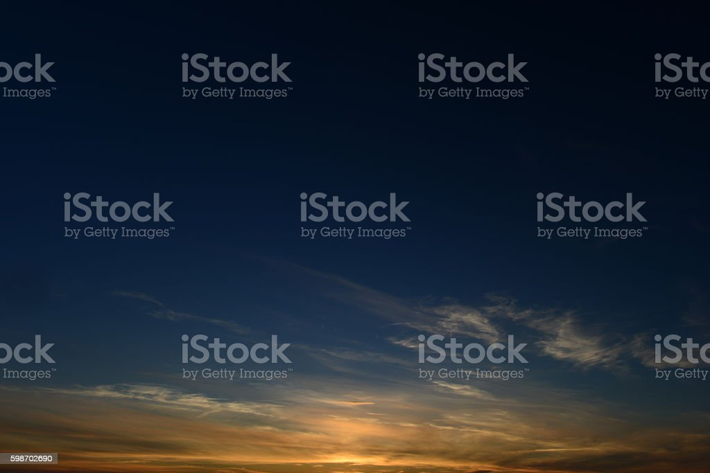 Cloudless clear blue sky summer sunset stock photo