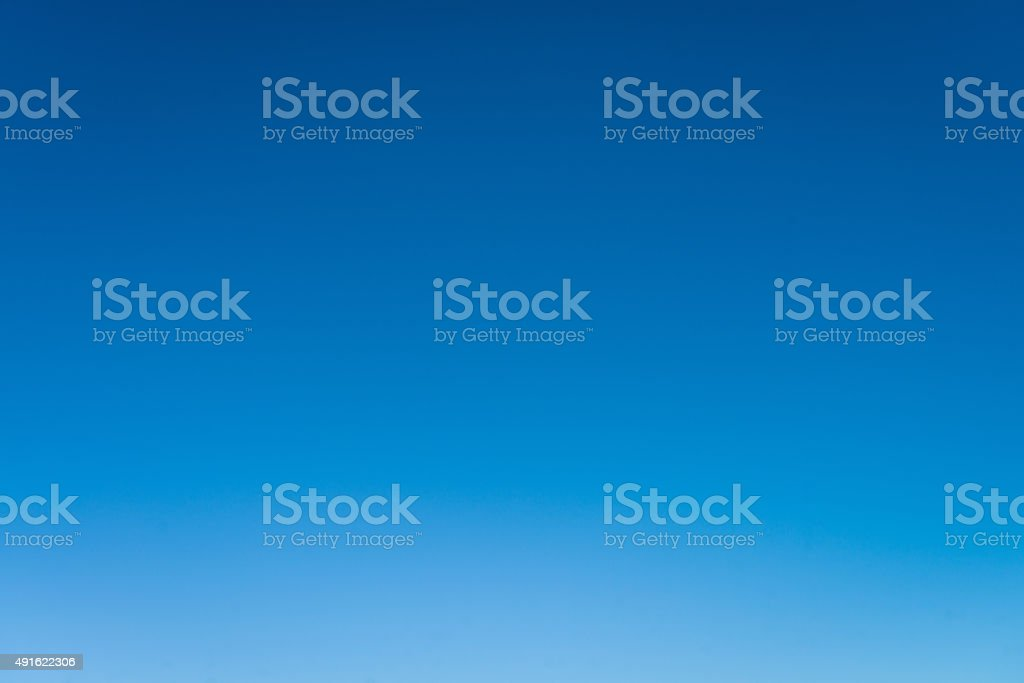 Cloudless empty blue sky background stock photo