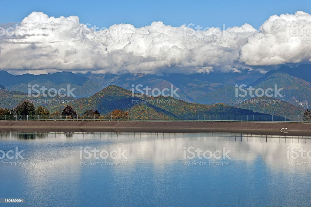 Clouds Above Accumulation Lake Ajba and Alps stock photo