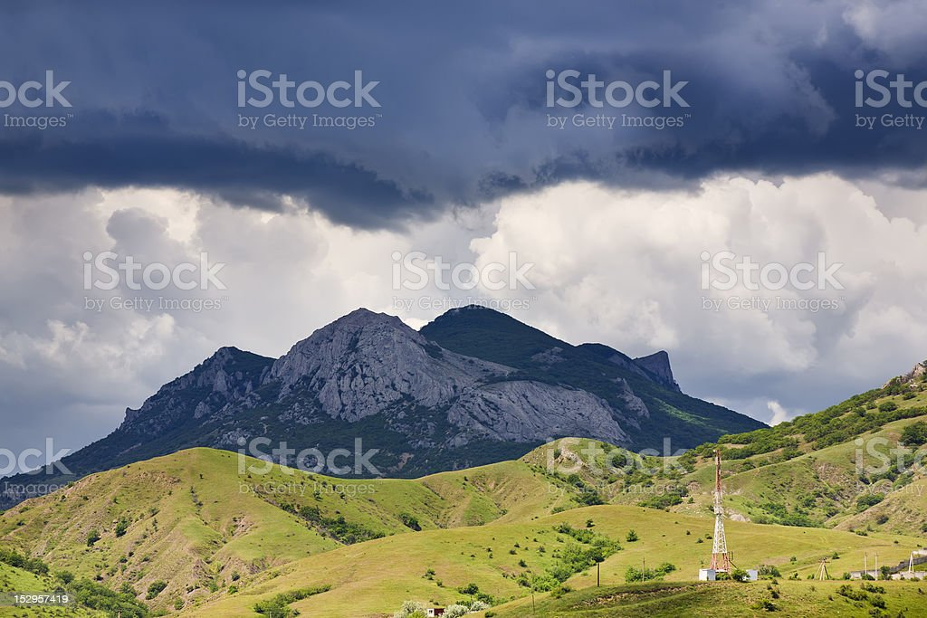 Clouds above mountains stock photo