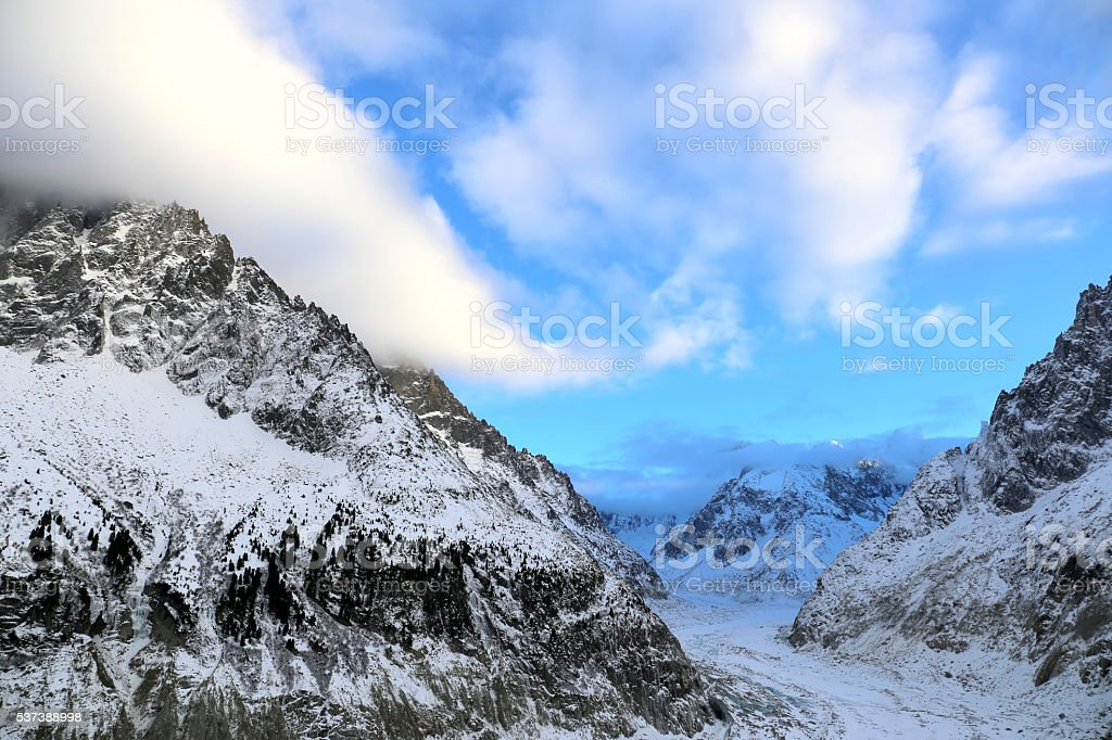 Clouds and blue sky on Mer de Glace, Chamonix stock photo