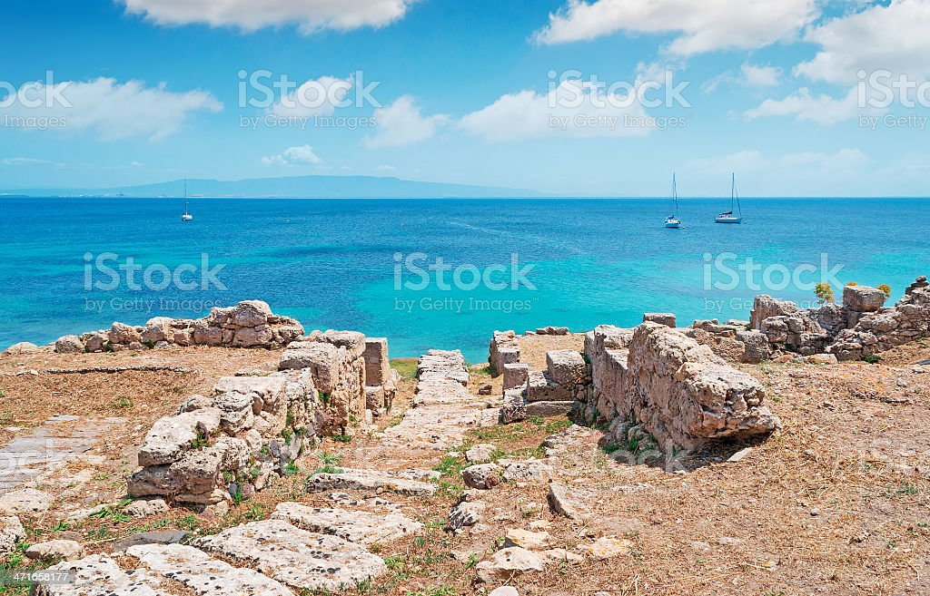 clouds and boats in Tharros royalty-free stock photo