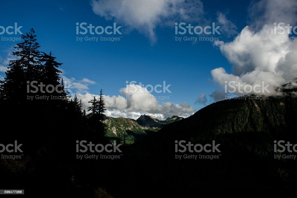 Clouds and Cliffs Alpine Scenery on Mount Rainier Washington stock photo