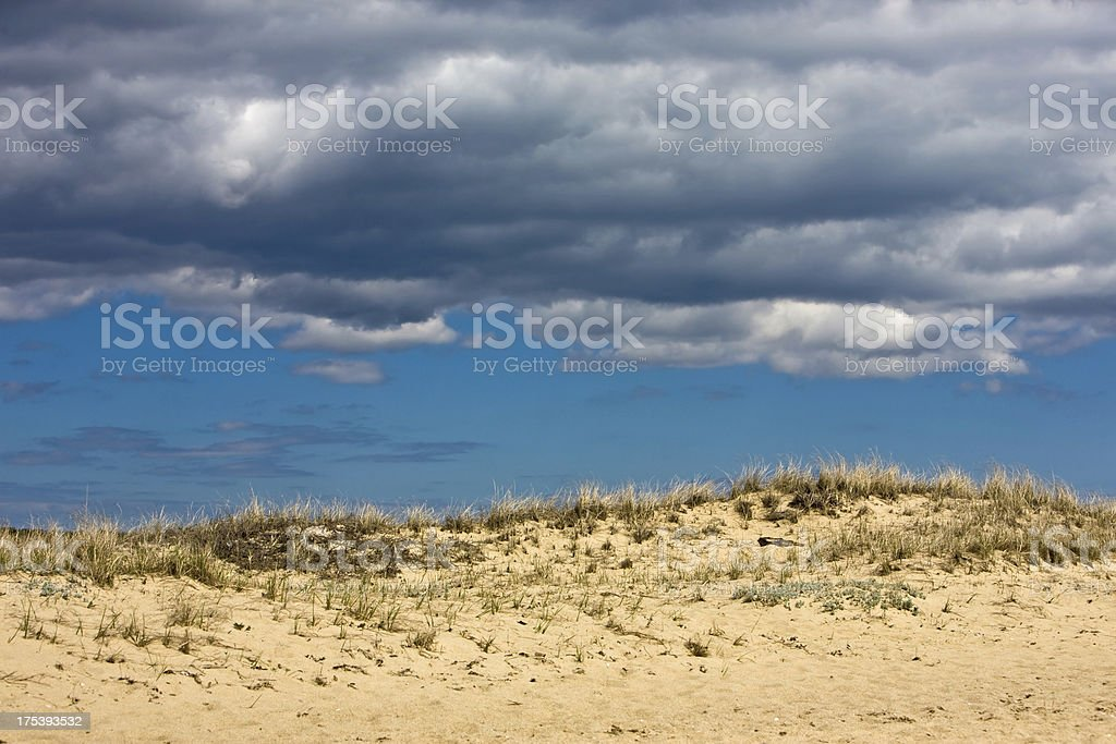 Clouds and Dune stock photo