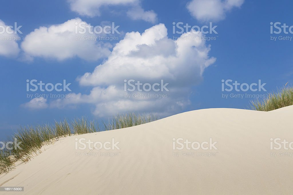 Clouds and dunes stock photo
