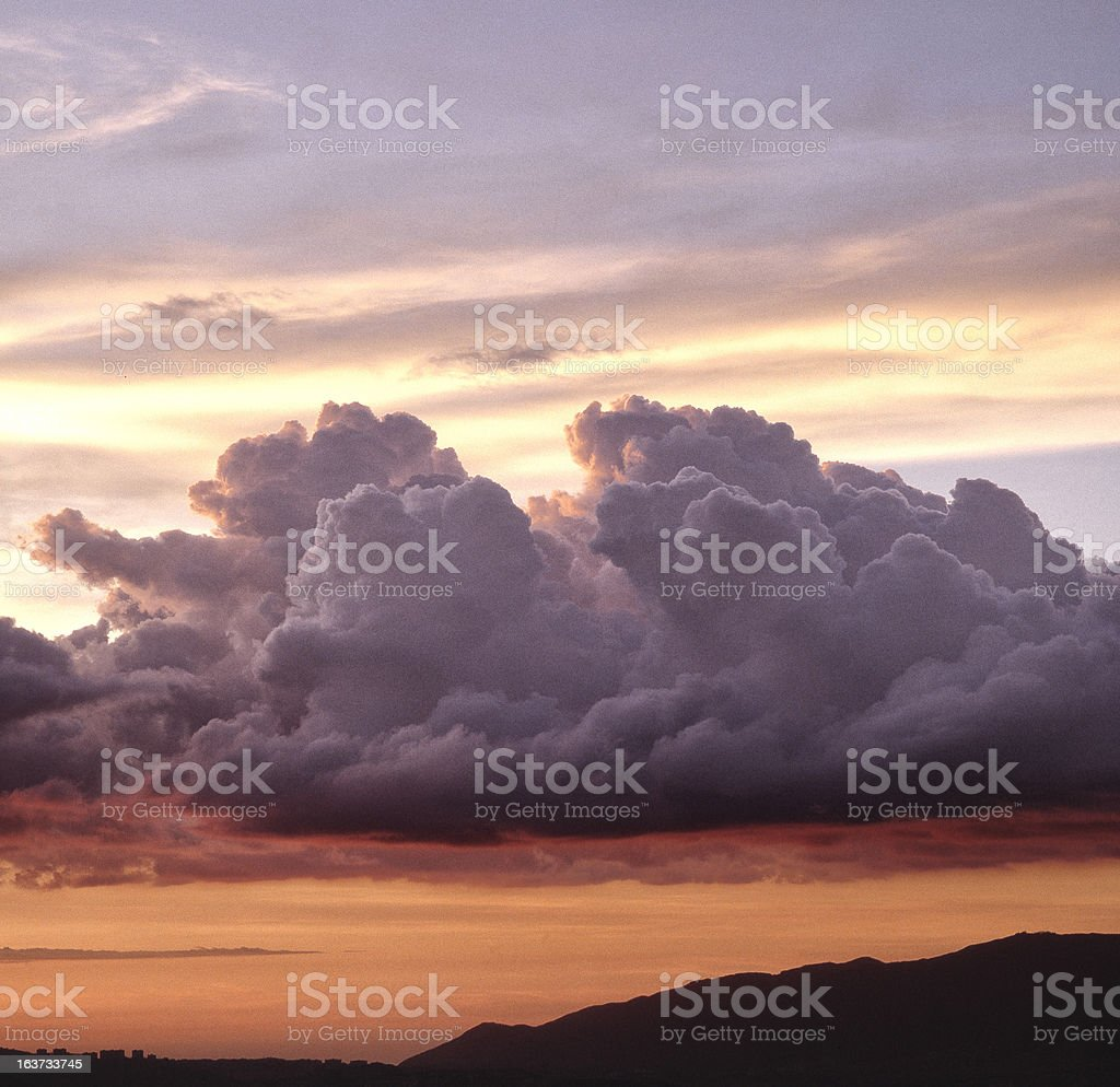 Clouds and mountain silhouette royalty-free stock photo