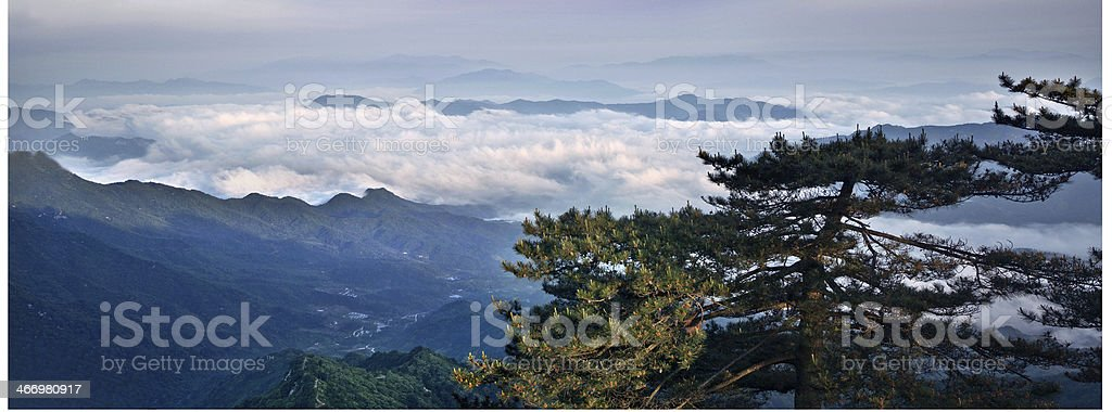 Clouds and mountains reflected royalty-free stock photo
