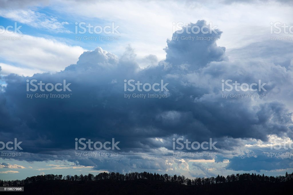 Clouds and silouette trees stock photo