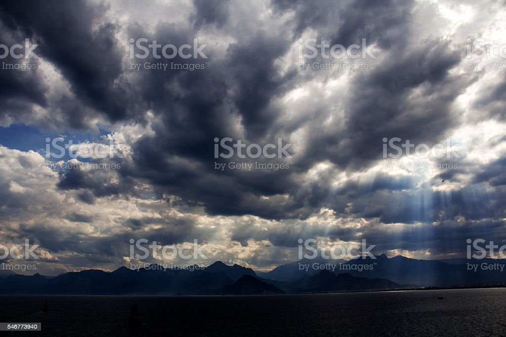 clouds and sun on the mountain . stock photo