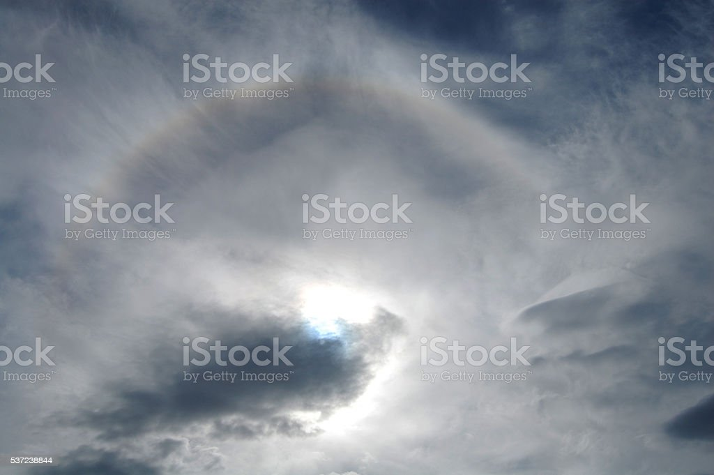 clouds and sun stock photo